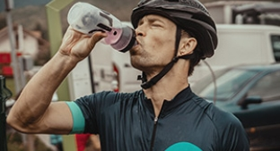 Cyclist drinking a sports nutrition beverage