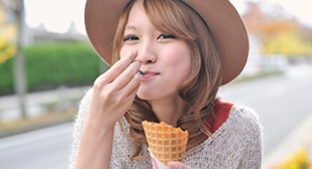Woman eating ice cream cone
